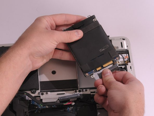 Unplug the hard drive cable that connects it to the main assembly.