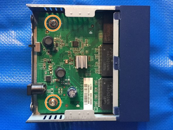 Use your PH2 bit or a Phillips #2 Screwdriver to remove the 6.94mm Phillips Head screws that hold the board into the bottom of the case.
