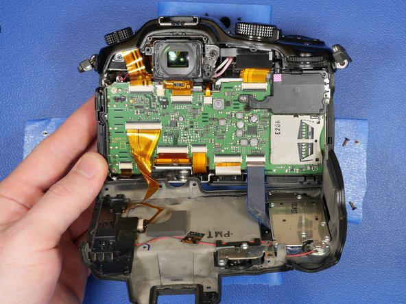 The rear LCD shell can be rotated away from the rest of the shell like a hinge.