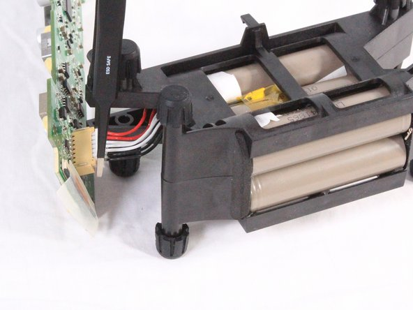 Using tweezers or your hand, carefully disconnect the bundled cables connecting the battery to the motherboard.