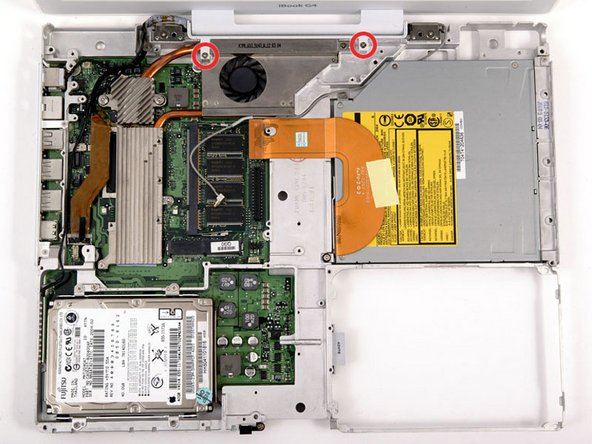 Image 1/1: The longer screw goes on the left (Laptop's right) side.