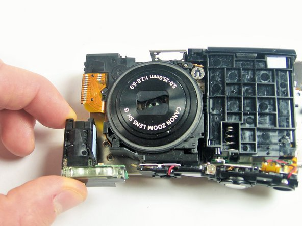 Gently pull the flash assembly away.