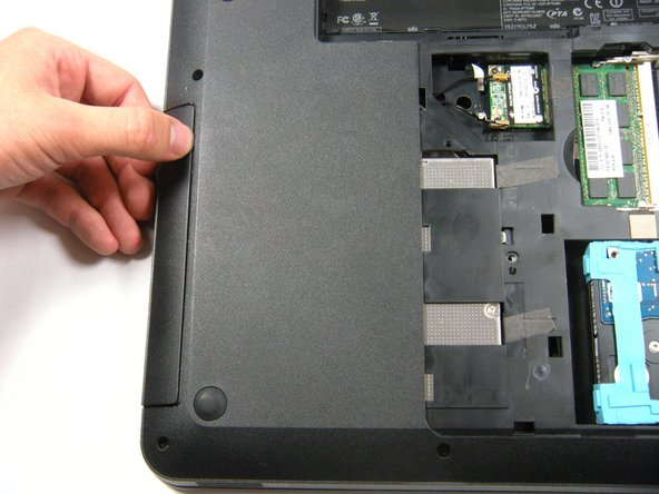 Slide the CD drive out from the exterior of the laptop.