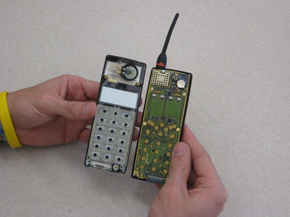 After removing the battery casing and taking apart the phone casing, the keypad is held in with a plastic skeleton structure as shown.