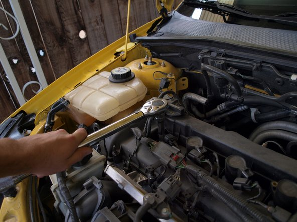 Tighten the spark plugs to 11 ft-lbs with a torque wrench.
