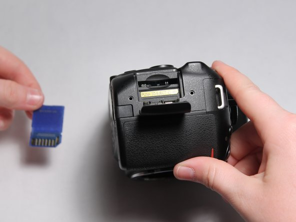 Press downward on the SD card to release it. It will pop out of its slot and can now be removed by pulling outward.