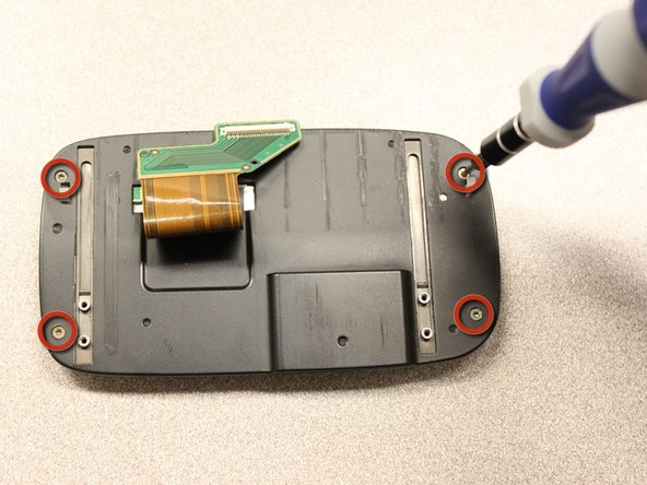 Use the T5 Torx screwdriver to remove four 5mm screws that secure the back of the screen casing.