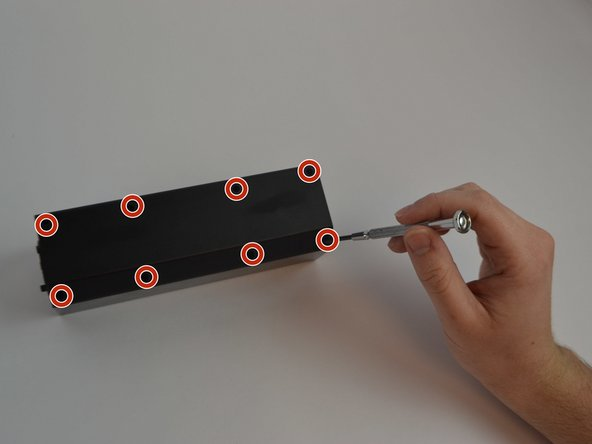"Flip the device upside down and remove all eight Phillips (Length-3/8"", Head-1/8"") Screws using a standard #1 Phillips screwdriver."