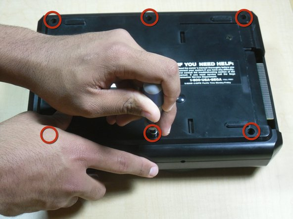 Remove the six screws from the underside of the console with a Phillips #1 screwdriver.