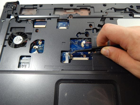 Locate and unplug the touchpad connection using the tweezers.