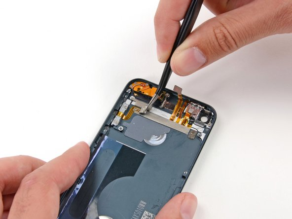 Image 2/3: Use tweezers or your fingers to peel the tape up from the rear case, and remove it from the iPod.