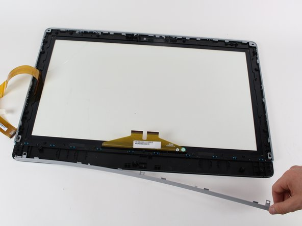Use your hands to pull the plastic bezel off of the digitizer.