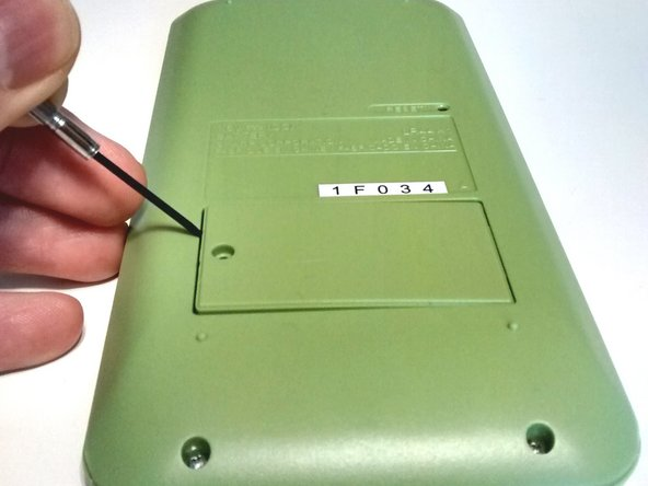 Image 1/3: Remove the battery door and place in small container.