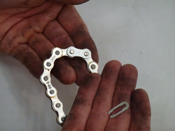 Once the clip is removed the chain should easily come apart.