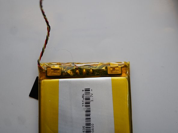 You can take the battery out by using a plastic card such as a credit card