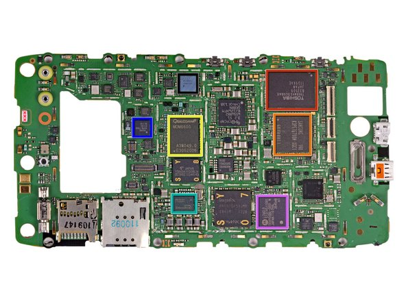 Image 1/1: Holy cannoli! Look at all 'em chips! To keep the design svelte, Motorola packed pretty much everything on one side of the mobo. Let's see what we're dealing with: