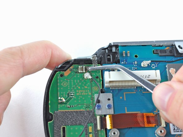 Using tweezers, slide the flex cable out of the socket.