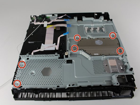 Unscrew and remove the six 4.0mm screws using a PH00 screwdriver with a counter-clockwise motion.