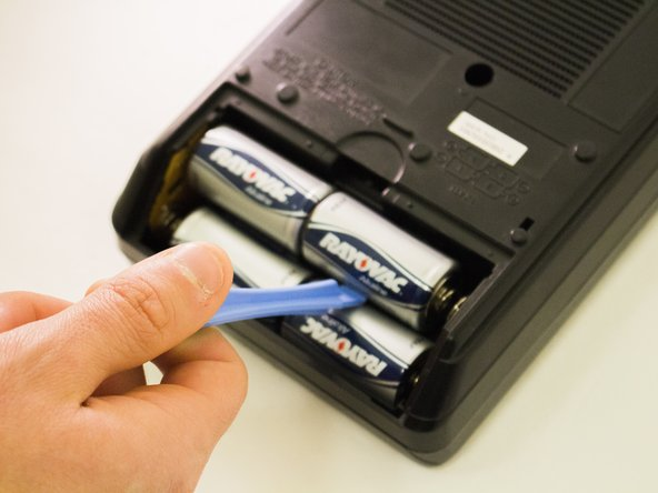 Remove the old batteries one at a time.