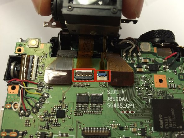 Carefully detach the two ribbon cables and detach the viewfinder.