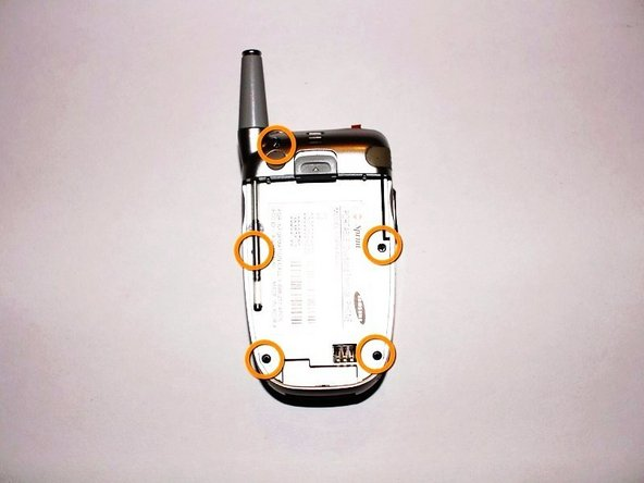 Once the battery pack is removed from the phone, remove the five indicated screws with a size #00 Philips screwdriver.