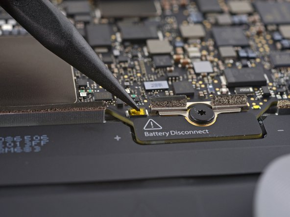 Image 2/3: We've seen something like this before—in the iPad, Apple loves to hide the battery connector under the logic board. This is the first time we've seen it in a laptop, so it looks like it's time for...