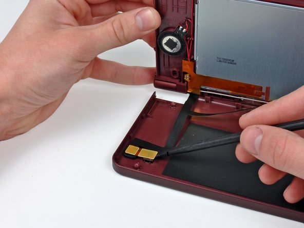 Use a spudger to pry the outward facing camera from its resting place on the top outer case.