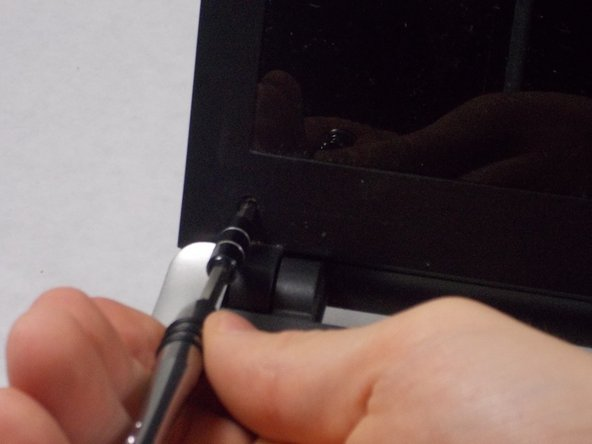 Use the PH1 Screwdriver to remove the screws