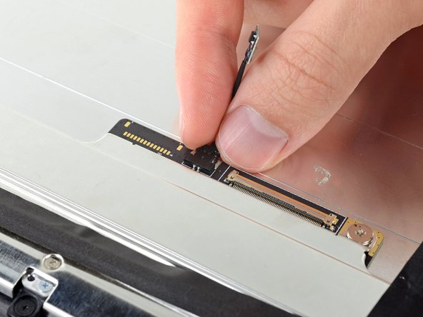 Image 1/2: Remove the thermal sensor and transfer it to your new display assembly.