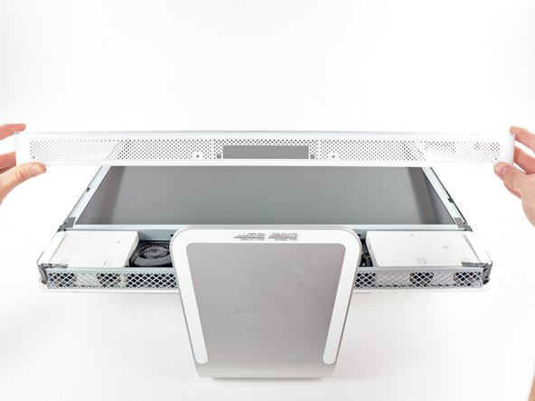 The third picture shows the top front bezel brackets and their slots cut into the top edge of the iMac's rear case.