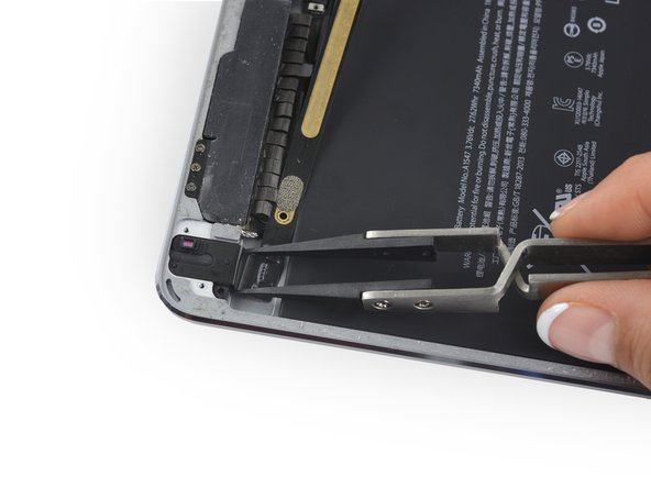 Pull the headphone jack straight back out of its recess.
