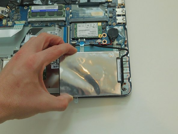 Move the hard drive case and hard drive so that you can easily reach the hard drive cable.