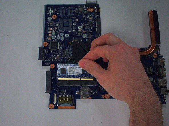 After the switches are released, simply pull the RAM up as shown.