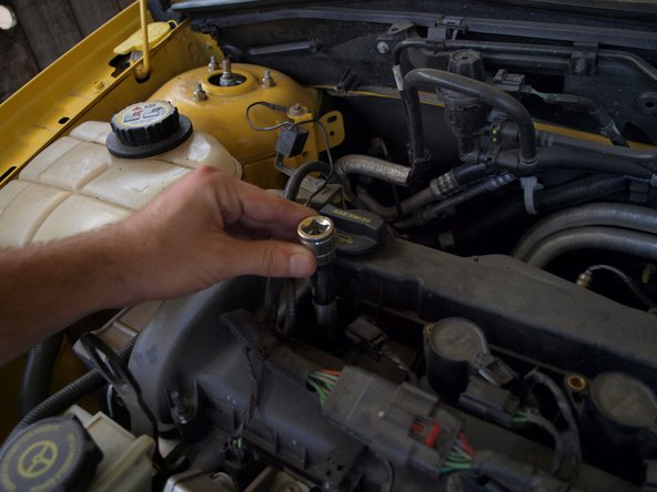 Image 2/3: Tighten the spark plugs to 11 ft-lbs with a torque wrench.