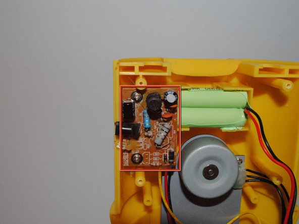 Image 1/2: Remove the two screws mounting the DC-in board.