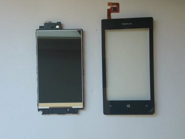 Again use a plastic tool to separate the middle frame and the digitizer frame.