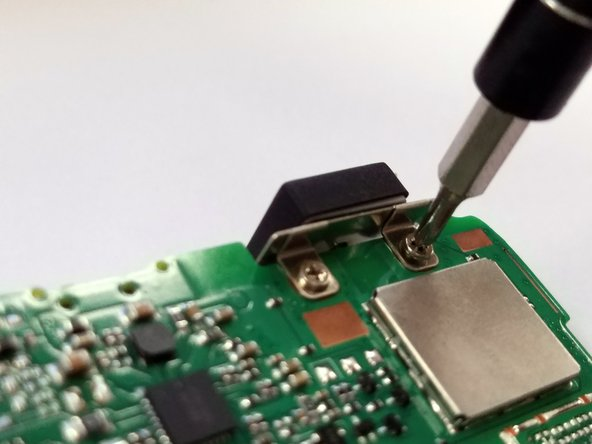 Remove the two 2.4mm Phillips #00 screws that hold the antenna to the motherboard.