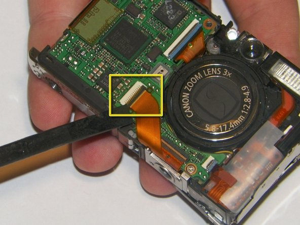 Image 1/3: Using a spudger, unsnap the jawbone connector that holds the cable in