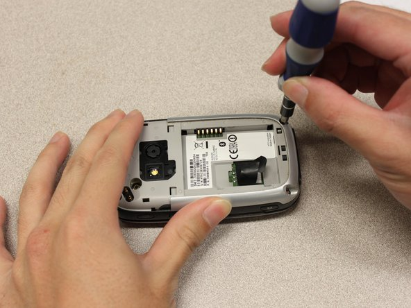 Use a T5 Torx screwdriver to remove four 6mm screws that secure the back panel to the main body.