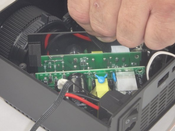 Lift the mirror behind the power supply circuit out to gain access to the circuit board.