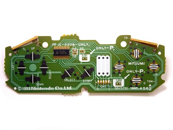 The SNES Controller board features a number of pads as well as a chip.