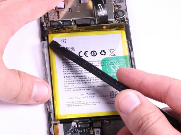 When reassembling the device, the spudger is not needed. Fold the flaps over so that the sticky side touches the yellow battery and connect the adhesive.