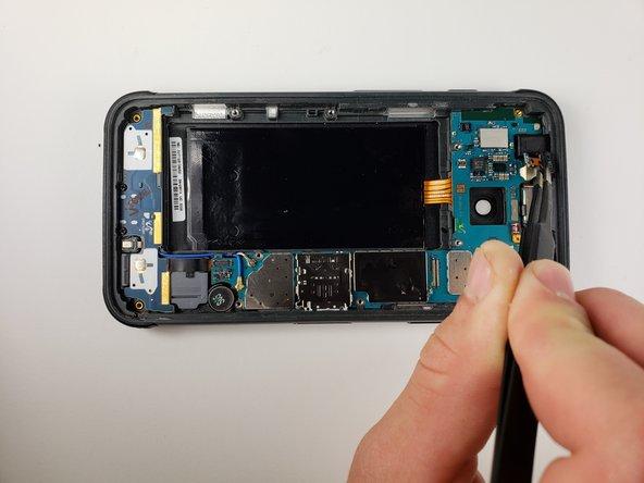 Use tweezers to remove the proximity sensor.
