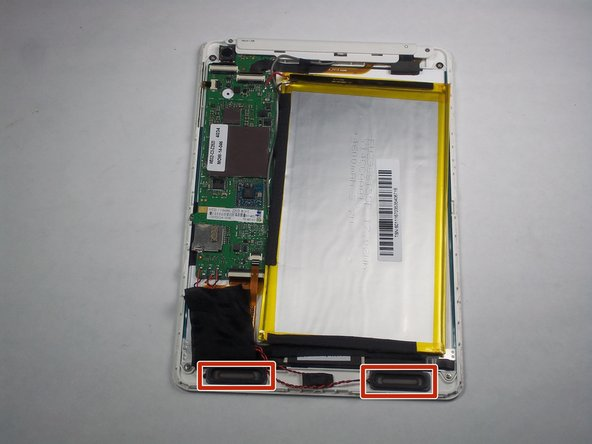 The speakers are located towards the bottom left and bottom right corners of the tablet.