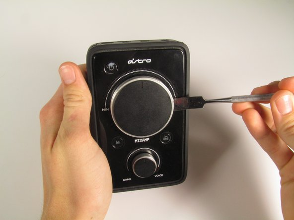 Remove the dials using either a metal spudger or your hands.  Be careful as the dials may be difficult to remove.