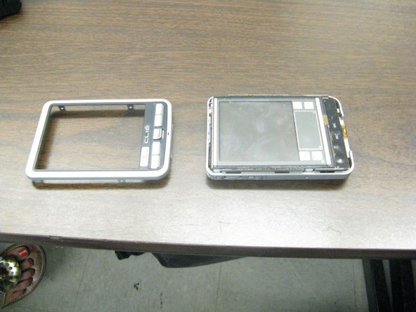 2. With an iPod opening tool, lift the front cover (face plate) from the device.
