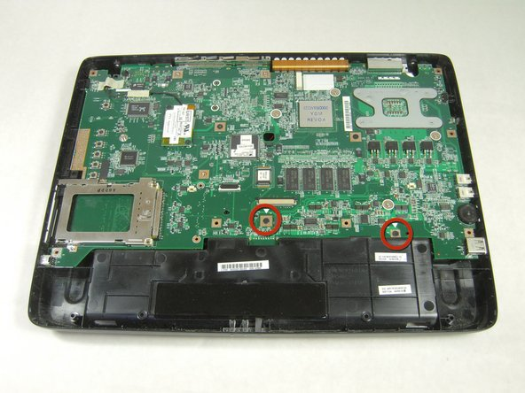 Using the Phillips Screwdriver, remove the two 8.6 mm screws from the front edge of the motherboard.
