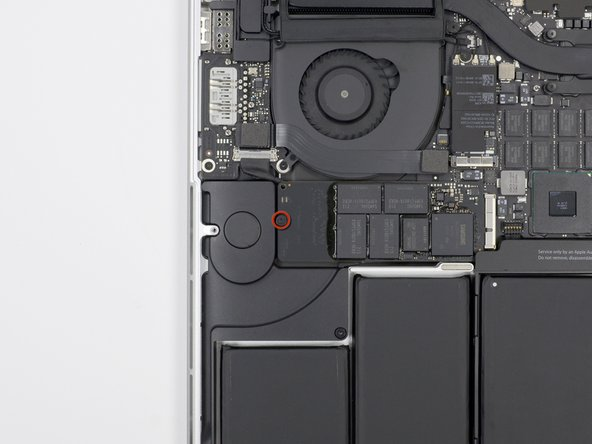 Remove the single 3.1 mm T5 Torx screw securing the SSD to the logic board.