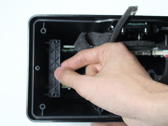 Remove the two plastic panels on either side of the device that hold the motherboard and power supply board in place.