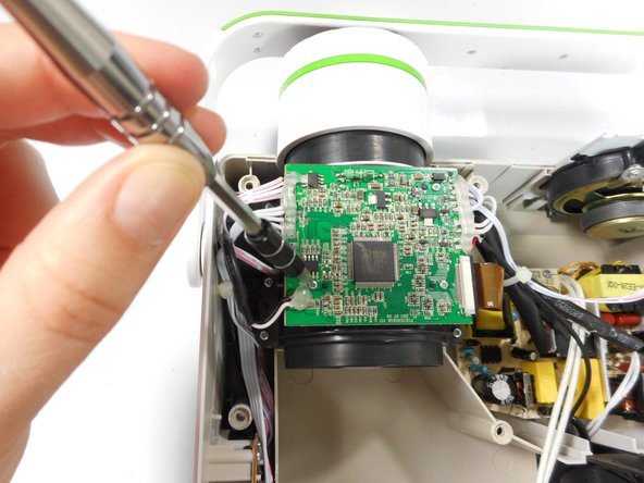 Unscrew the three 7 mm screws from the motherboard with the Phillips #0 screw driver.